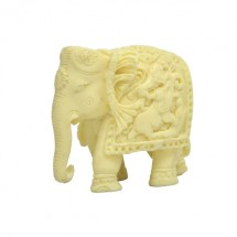 Ivory like Elephant with carving